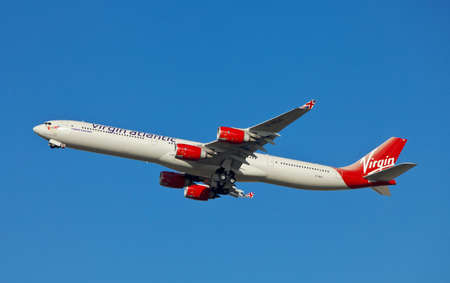 LONDON - FEBRUARY 19: A Virgin Atlantic Airbus A340 leaves Heathrow on route to the US on February 19, 2012 in London, England. Virgin
