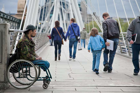 LONDON, MAY 9: A disabled man waits on Hungerford bridge for passers by to give him aid money on May 9, 2010 in London. Homelessness in England had risen by 42% in 2010 to 1,768, from 1,247 in 2009.
