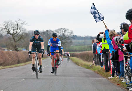barrett: CLAYDON, ENGLAND - MARCH 10: Matthew Barrett of the Cycle Shack team crosses the finishing line in first place just ahead of Gavin Atkins of HHCC at the Spring Chicken RR on March 10, 2012 in Claydon