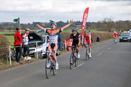 narrowly: CLAYDON, ENGLAND - MARCH 10: Philip Lavery of the Node4 cycling team crosses the finishing line in first place at the Roy Thame Cup, narrowly beating Richard Lang on March 10, 2012 at Claydon.