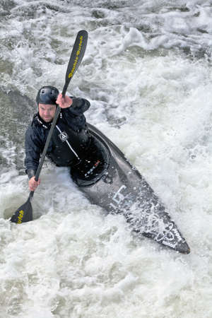 SHEPPERTON, ENGLAND - MARCH 11 - An unnamed kayaker gets his boat into line before executing the first downhill slalom section at the Shepperton CC slalom competiton on March 11, 2012 at Shepperton