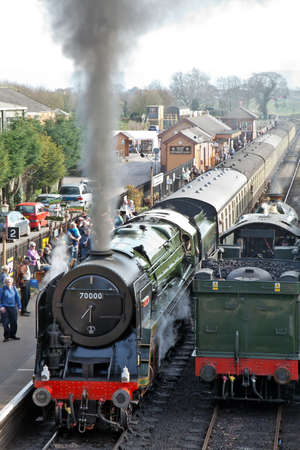 britannia: BISHOPS LYDEARD, ENGLAND - MARCH 25: Pacific loco Britannia sits at the station alongside ex GWR express loco King Edward I during the WSR spring steam gala event on March 25, 2012 at Bishops Lydeard