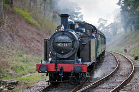 GROOMBRIDGE, ENGLAND - APRIL 15: Jinty tank engine 47493 approaches Groombridge station with a train of enthusiasts during the Spa Valley Railway spring steam gala on April 15, 2012 at Groombridge  Stock Photo - 13364991