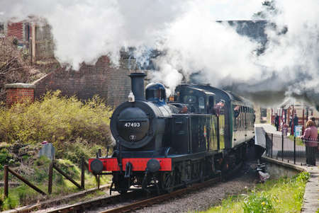 GROOMBRIDGE, ENGLAND - APRIL 15: Jinty tank engine 47493 pulls out of Groombridge station with a train of enthusiasts during the Spa Valley Railway spring steam gala on April 15, 2012 at Groombridge  Stock Photo - 13364999