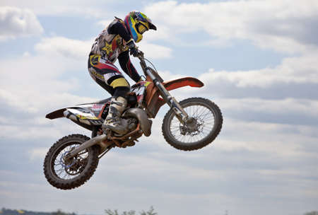STANBRIDGE, ENGLAND - MAY 13: An unnamed moto-X rider leaves the ground getting big air after hitting a jump ramp at full speed during the DunstableMX practice session on May 13, 2012 at Stanbridge  Editorial