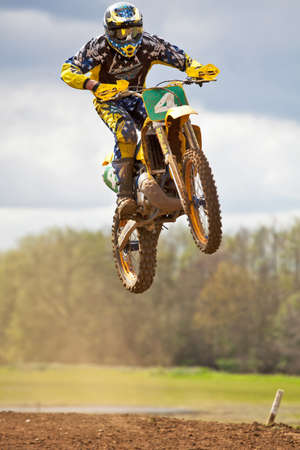 CULHAM, ENGLAND - MAY 5: An unnamed moto-X rider in the modern bikes block takes one of the back leg junps at speed during the Culham Park vintage moto-X event on May 5, 2012 at Culham