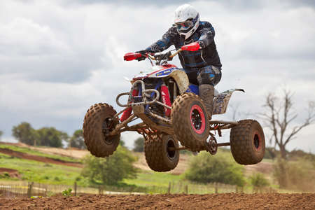 CULHAM, ENGLAND - MAY 5: An unnamed quad bike rider takes a jump ramp at speed during the quad & trike race at the Culham Park moto-X vintage bikes weekend on May 5, 2012 at Culham  Stock Photo - 13714843