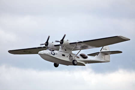 ABINGDON, ENGLAND - MAY 6: A Consolidated PBY Catalina seaplane gives a low level flypast to the public at the Abingdon airshow on May 6, 2012 at Abingdon Editorial