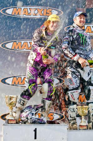 acu: MILTON MALSOR, ENGLAND - MAY 27: Matiss Karro, winner of the ACU British Moto-X MX1 championship, Round 4, celebrates victory alongside second place Shaun Simpson on May 27, 2012 at Milton Malsor