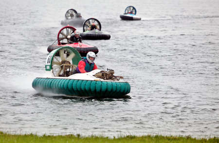 NOTTINGHAM, UK - JUNE 2: Fred Wilson in his F1X racing hovercraft leads the chasing pack ashore at Big Lake during the UK Hovercraft Championships, Round 2, on June 2, 2012 in Nottingham, UK