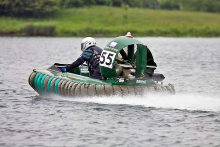 hovercraft: NOTTINGHAM, UK - JUNE 2: An unnamed driver of an F503 class racing hovercraft speeds across Big Lake during qualifying for the UK Hovercraft Championships, Round 2, on June 2, 2012 in Nottingham, UK