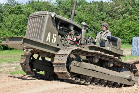 PORTSMOUTH, UK - JUNE 3: A vintage US Army WW2 bulldozer exits a tank trap during the military vehicle parade at the Overlord Military show on June 3, 2012 at Portsmouth Stock Photo - 14147428