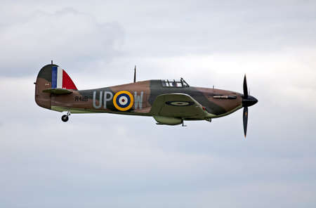 ABINGDON, UK - MAY 6: The last remaining airworthy Battle of Britain Hawker Hurricane, R4118, gives a low level aerial flypast at the Abingdon airshow on May 6, 20112 at Abingdon