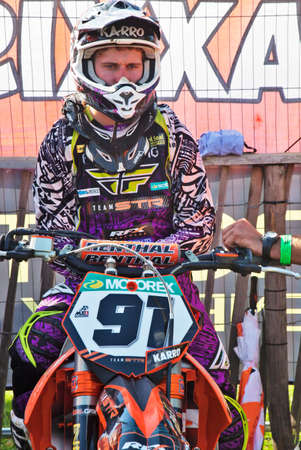 milton: MILTON, UK - MAY 27: Karro Mattis sits in the pits on his MX bike awaiting the start of the meetings final MX1 class race in the ACU Maxxis MX UK championship on May 27, 2012 in Milton  Editorial