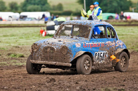 ST NEOTS, UK - JULY 7: Adam Saint in his Austin A35 Pinto approaches a muddy tight right hand corner at the Bob Robins memorial autograss Championships on July 7, 2012 at St Neots