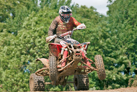 mx: ENSTONE, UK - JUNE 24: An unnamed quad bike rider takes a jump at speed during the UK Nora MX Quad championships on June 24, 2012 in Enstone  Editorial