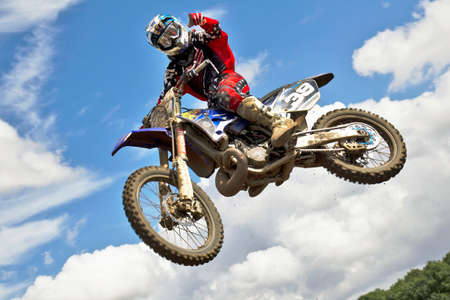 DUNSTABLE, UK - AUGUST 4: An unnamed rider takes flight off of a kicker jump during a pre-race motocross practice session at the DMX circuit on August 4, 2012 at Dunstable