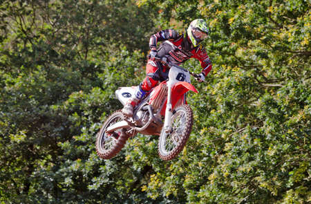 acu: HOPTON, UK - JULY 29: MX1 rider Max Anstie takes a leap off of the table top at Hawkstone Park en route to a creditable overall third place during the ACU UK MX championship on July 29, 2012 at Hopton