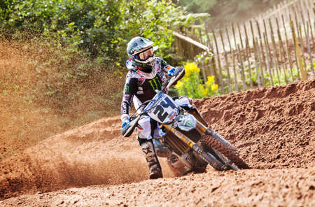 HOPTON, UK - JULY 29: MX1 rider Shaun Simpson accelerates up Hawkstone hill in deep sand en route to taking an overall second place for the day at the ACU UK MX championship on July 29, 2012 at Hopton