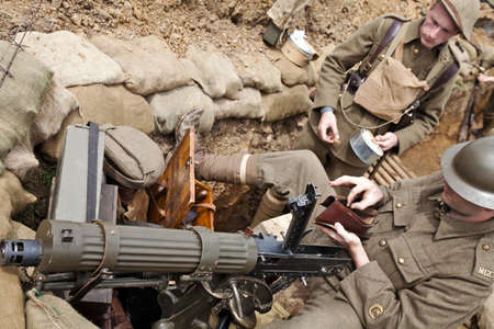 BELTRING, UK - JULY 19: Re-enactors in British Army WW1 uniform clean an authentic Vickers machine gun whilst posing in replica trench systems at the War & Peace show on July 19, 2012 at Beltring  Stock Photo - 14833964