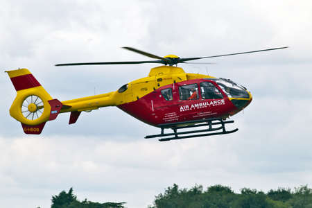 BENSON, UK - AUGUST 23:The Chilterns air ambulance lands at Benson airfield on August 23, 2012 at Benson. The AAS is the busiest voluntary emergency service in the UK with average costs of £165K pm