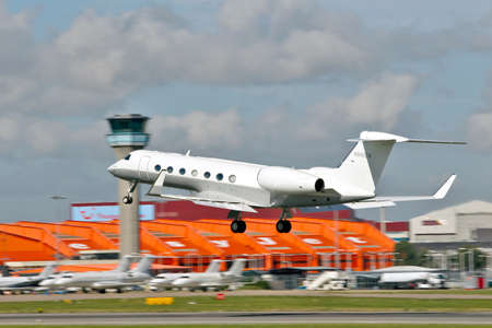 LUTON, UK - SEPTEMBER 13:A Gulfstream G-V G500 business jet departs Luton airport on September 13, 2012 at Luton.191 G-V units, each with a range of 11,000Km  have been produced for the private sector