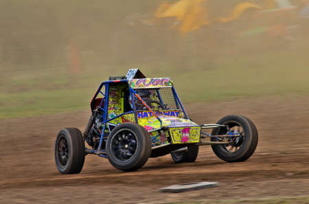 hathaway: GLOUCESTER, UK - SEPTEMBER 16:J Hathaway takes her Class10 autograss special around the Gloucester circuit in a cloud of dust at the Southern autograss championship on September 16, 2012 at Gloucester