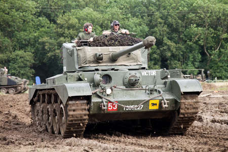 showground: BELTRING, UK - JULY 19: A preserved British Army WW2 Comet tank gives a display of maneuver and hide in the parade ring at the War and Peace show at Beltring on July 19, 2012