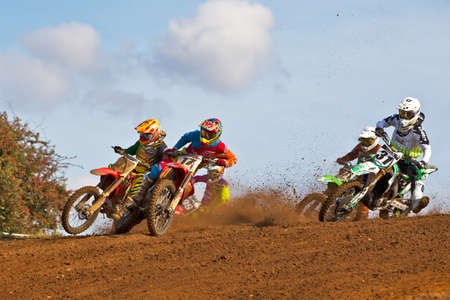 moto2: CULHAM, UK - SEPTEMBER 22: Jason Dougan, number17,  leads Alex Snow and Gert Krestinov into turn one at Culham Park during the UK Red Bull Pro Nationals MX1 class moto2 on September 22, 2012 at Culham