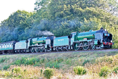 MEDSTEAD, UK - SEPTEMBER 9: Ex Southern locomotive 925 Cheltenham, leads sister Southern loco 825 Lord Nelson towards Ropley station at the Mid Hants autumn steam gala on September 9, 2012 at Medstead  Stock Photo - 15452848
