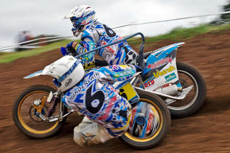 acu: WAKES COLNE, UK - SEPTEMBER 2: Richard Jenkins & Dan Chamberlain lead their MX sidecar rig to an overall 3rd place at the ACU UK National sidecar MX Championship on September 2, 2012 at Wakes Colne  Editorial