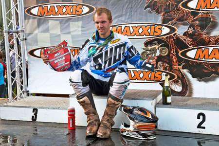acu: LANGRISH, UK - AUGUST 27: Kevin Strijbos celebrates an overall first place in the ACU Maxxis UK MX Championship, MX1 class, during Round 7 at the Langrish MX circuit on August 27, 2012 at Langrish
