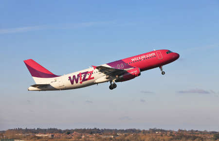 jetliner: LUTON, UK - MARCH 28: A Hungarian Wizzair Airbus A320 jetliner leaves London Luton Airport on March 28, 2012 at Luton. Wizzair carried 11Mn passengers in 2011, an increase of 15% from 2010  Editorial