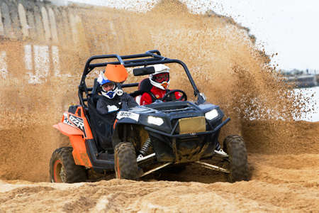 unnamed: RAMSGATE, UK - OCTOBER 20: An unnamed driver racing in the SXS class takes his Polaris RZR around a hairpin corner at speed during the QRA MCF beach-X UK nationals race on October 20, 2012 in Ramsgate Editorial