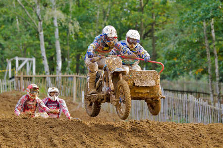 acu: SWANLEY, UK - OCTOBER 7: Richard Jenkins & Dan Chamberlain take the second jump in a two stage step down during the ACU British sidecar Nationals MX at Canada Heights on October 7, 2012 in Swanley Editorial