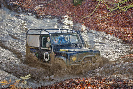 TRING, UK - NOVEMBER 25: An unnamed driver of the Burnham off road 4x4 club attempts to beat a specially designed off road 4x4 trials course during a club practice event on November 25, 2012 in Tring