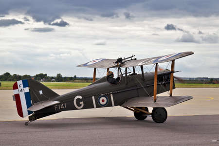 BENSON, UK - AUGUST 23: A WW1 SE5a fighter aircraft taxis out for takeoff after giving a display earlier in the day at the Benson airshow on August 23, 2012 in Benson