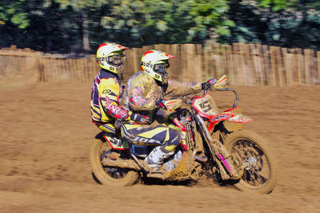 acu: SWANLEY, UK - OCTOBER 7: Luke Peters takes his MX sidecar rig through knee deep mud during the ACU UK national sidecar championships on the Canada Heights circuit on October 7, 2012 in Swanley