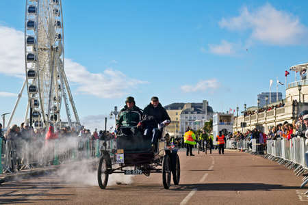 steam rally: BRIGHTON, UK - NOVEMBER 4: A 1900 Mobile Steam Runabout automobile approaches the finishing line at the end of the annual London to Brighton veterans race on November 4, 2012 in Brighton