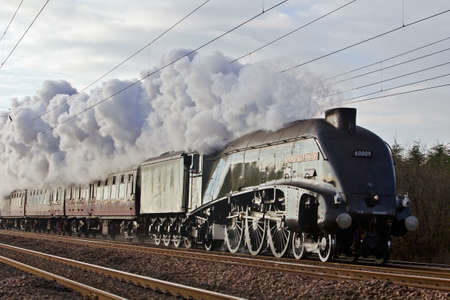 BIGGLESWADE, UK - DECEMBER 8: Ex LNER A4 pacific locomotive Union of South Africa takes charge of the Lindum Fayre steam excursion trip from London to Lincoln, on December 8, 2012 in Biggleswade Editorial