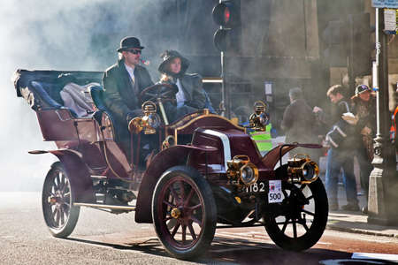 LONDON - NOVEMBER 3:An unidentified veteran participant of the Regent St motor show enters Regent St through an early morning mist to take its place on the static line up on November 3, 2012 in London