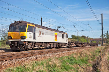 freightliner: HITCHIN, UK - APRIL 6: A class92 freight loco enters Hitchin with a returns train of empties on April 6, 2011 in Hitchin. Between 1993-96, 46 of these locos were produced for Channel tunnel operations  Editorial