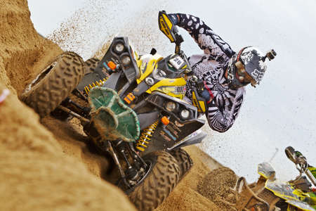 RAMSGATE, UK - OCTOBER 20: Clyde Thompson takes a tight left handed bank on his enduro style Quad during the MCF QRA beach-x UK championships on October 20, 2012 in Ramsgate