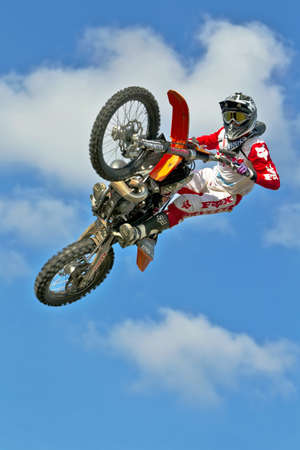 mx: CULHAM, UK - SEPTEMBER 22: An unnamed freestyle MX rider hits the apex of his jump before landing onto a lorry roof during the Red Bull Pro MX UK Nationals on September 22, 2012 in Culham