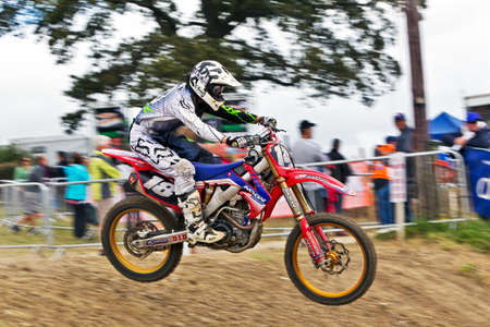 acu: LANGRISH, UK - AUGUST 27: An unnamed rider competing in the Rookie class takes a jump at speed on the Langrish circuit during the ACU Maxxis UK Nationals MX championship on August 27, 2012 in Langrish