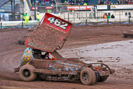 unnamed: COVENTRY, UK - DECEMBER 26: An unnamed driver in an F1 stock car negotiates a muddy left hand slide at Coventry Raceway track during the Boxing Day Specials meeting on December 26, 2012 in Coventry