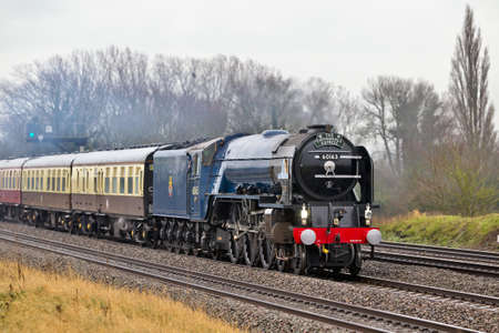 mainline: DIDCOT, UK - NOVEMBER 24: Pacific steam locomotive Tornado on its first mainline trip since being repainted in BR blue, takes the Cathedrals Express through Oxfordshire on November 24, 2012 in Didcot.  Editorial