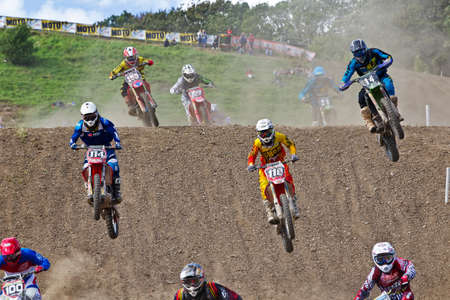 mx: LANGRISH, UK - AUGUST 27: Unnamed riders take a large step-down jump at speed during the  ACU Maxxis UK MX championships on August 27, 2013  in Langrish.