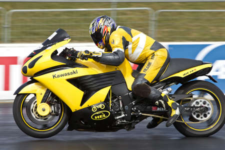PODINGTON, UK - APRIL 7: An unnamed rider takes his ZX14R to an overall first place at the Santa Pod Raceway during the ACU Straight liners championship on April 7, 2013 in Podington Stock Photo - 19169325