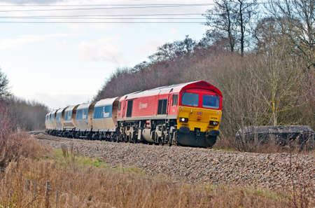 KINTBURY, UK - MARCH 11: A DB class 59 diesel locomotive takes a heavy freight train of stone towards London on March 11, 2013 in Kintbury. DBS employs 94,600 staff worldwide, turning over E19.8Bn p.a Stock Photo - 19852124